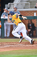 University of North Carolina Greensboro (UNCG) Spartans third baseman Caleb Webster (1) runs to first base during a game against the Tennessee Volunteers at Lindsey Nelson Stadium on February 24, 2018 in Knoxville, Tennessee. The Volunteers defeated Spartans 11-4. (Tony Farlow/Four Seam Images)