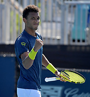 MIAMI GARDENS, FLORIDA - MARCH 26: Felix Auger-Aliassime of Canada defeats Pierre-Hugues Herbert of France on Day 5 of the 2021 Miami Open on March 26, 2021 in Miami Gardens, Florida<br /> <br /> <br /> People:  Felix Auger-Aliassime