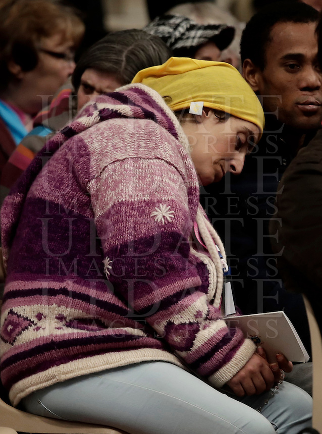 A woman waits for the start of a Jubilee Mass for homeless people celebrated by Pope Francis in Saint Peter's Basilica at the Vatican November 13, 2016.<br /> UPDATE IMAGES PRESS/Isabella Bonotto<br /> <br /> STRICTLY ONLY FOR EDITORIAL USE