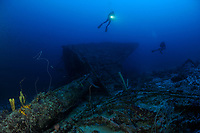 scuba diver hovers over bow sprit of ship wreck Mairi Bahn, aka Windjammer, Bonaire, Netherlands Antilles, Caribbean, Atlantic