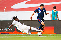 GUADALAJARA, MEXICO - MARCH 28: Christopher Melendez #5 of Honduras slide tackles Aaron Herrera #17 of the United States during a game between Honduras and USMNT U-23 at Estadio Jalisco on March 28, 2021 in Guadalajara, Mexico.