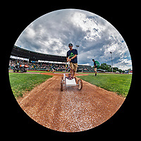 21 July 2019: A member of the Vermont Lake Monsters grounds crew paints the base path lines on the field prior to a minor league baseball game between the Vermont Lake Monsters and the Tri-City ValleyCats at Centennial Field in Burlington, Vermont. The Lake Monsters rallied to defeat the ValleyCats 6-3 in NY Penn League play. Mandatory Credit: Ed Wolfstein Photo *** RAW (NEF) Image File Available ***