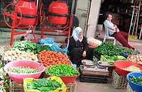 "A Palestinian Woman selling vegetable look at an empty market after the economic blockade imposed on them after the victory of Hamas in the legislative elections last year May.20.2007""photo by Fady Adwan"""
