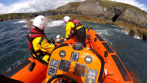 The RNLI lifeboat crew rescued three kayakers stranded on rocks at Kilmurrin Cove
