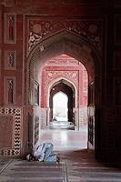 Agra, India.  Taj Mahal Mosque.  Man Praying.