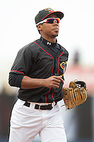 Quad Cities River Bandits outfielder Teoscar Hernandez #4 looks on during a game against the Great Lakes Loons at Modern Woodmen Park on April 29, 2013 in Davenport, Iowa. (Brace Hemmelgarn/Four Seam Images)