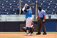 Tampa Tarpons Andres Chaparro (24) awaits the pitch as umpire Rainiero Valero looks on during a game against the Fort Myers Mighty Mussels on May 23, 2021 at George M. Steinbrenner Field in Tampa, Florida.  (Mike Janes/Four Seam Images)