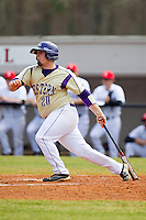Tyler White (20) of the Western Carolina Catamounts follows through on his swing against the Davidson Wildcats at Wilson Field on March 10, 2013 in Davidson, North Carolina.  The Catamounts defeated the Wildcats 5-2.  (Brian Westerholt/Four Seam Images)