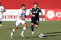 RICHMOND, VA - SEPTEMBER 30: Manny Perez #2 of North Carolina FC is chased by Jake LaCava #64 of New York Red Bulls II during a game between North Carolina FC and New York Red Bulls II at City Stadium on September 30, 2020 in Richmond, Virginia.