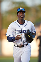 Charlotte Stone Crabs right fielder Jesus Sanchez (4) jogs back to the dugout during a game against the Palm Beach Cardinals on April 20, 2018 at Charlotte Sports Park in Port Charlotte, Florida.  Charlotte defeated Palm Beach 4-3.  (Mike Janes/Four Seam Images)