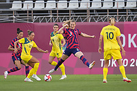 KASHIMA, JAPAN - AUGUST 5: Kyah Simon #17 of Australia battles for the ball with Samantha Mewis #3 of the United States during a game between Australia and USWNT at Kashima Soccer Stadium on August 5, 2021 in Kashima, Japan.