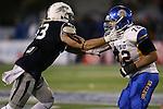 Nevada's Brock Hekking blocks San Jose State's Wes Schweitzer in an NCAA college football game in Reno, Nev., on Saturday, Nov. 16, 2013. (AP Photo/Cathleen Allison)