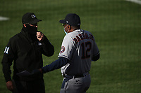 OAKLAND, CA - AUGUST 7:  Manager Dusty Baker #12 of the Houston Astros talks with umpire Quinn Wolcott while wearing a mask before the game against the Oakland Athletics at the Oakland Coliseum on Friday, August 7, 2020 in Oakland, California. (Photo by Brad Mangin)