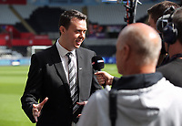 Letou CEO Paul Fox is interviewed by a television crew during the English Premier League soccer match between Swansea City and Manchester United at Liberty Stadium, Swansea, Wales, UK. Saturday 18 August 2017