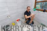 Ian O'Sullivan bathroom renovations at the tiling stage on Thursday.