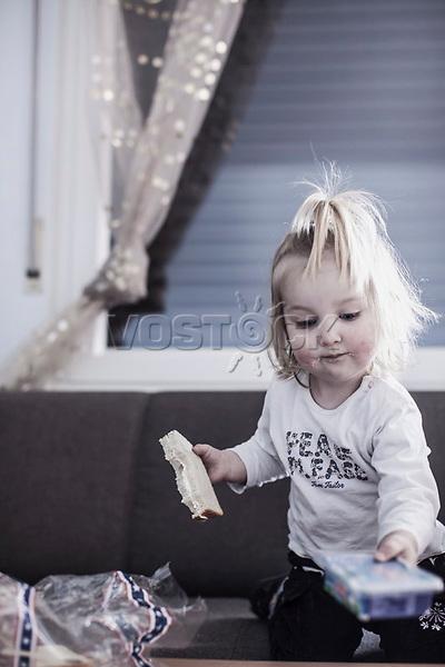 Maedchen mit Frischkaesebrot, HartzIv, Bochum<br /> <br /> *** HighRes auf Anfrage *** Voe nur nach Ruecksprache mit dem Fotografen *** Sonderhonorar ***<br /> <br /> Engl.: Europe, Germany, Bochum, unemployment benefit, Hartz IV, unemployed, unemployment, poverty, poor, social benefits, child, girl, eating bread, portrait, 28 March 2012<br /> <br /> ***Highres on request***publication only after consultation with the photographer***special fee***