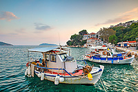 The sunset at the old port in the Chora of Skiathos island, Greece