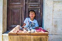 He sells sea shells - Valentin selling seashells on Kastellorizo, Greece