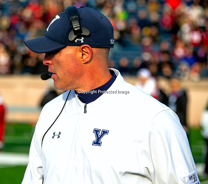 """November 23, 2019:  Yale coach looks on in a stunning comeback that mirrored 1968. The Yale Bulldogs defeat Harvard in double """"OT"""" 50-43.  Yale came from down 17 late in the fourth quarter, including recovering an onside kick with a minute left at the Yale Bowl in New Haven Connecticut.Dan Heary/Eclipse Sportswire/CSM"""