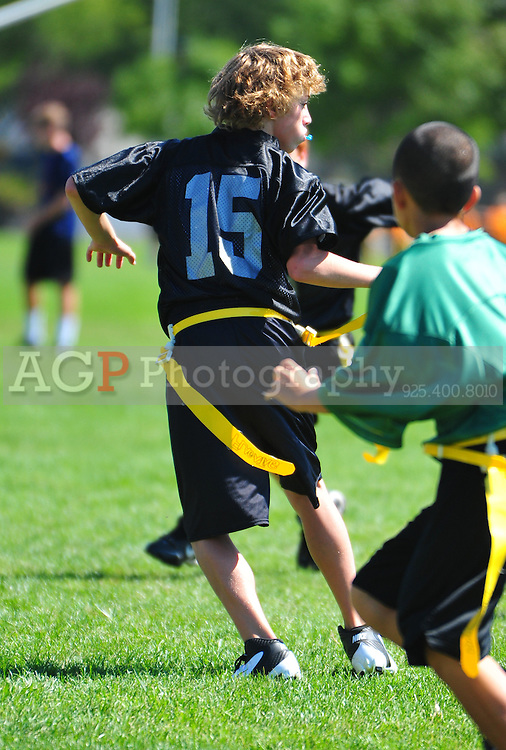 The PJFL Senior Eagles battle the Raiders  in Pleasanton, California.  (Photo by Alan Greth/AGP Photography).