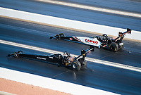 Nov 3, 2019; Las Vegas, NV, USA; NHRA top fuel driver Mike Salinas (near) races alongside Steve Torrence during the Dodge Nationals at The Strip at Las Vegas Motor Speedway. Mandatory Credit: Mark J. Rebilas-USA TODAY Sports