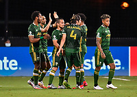 LAKE BUENA VISTA, FL - JULY 18: Diego Valeri #8 of the Portland Timbers celebrates his goal with teammates during a game between Houston Dynamo and Portland Timbers at ESPN Wide World of Sports on July 18, 2020 in Lake Buena Vista, Florida.