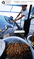 Dog meat kebabs. Dog meat is considered a delicacy in Vietnam with increasing numbers being illegally stolen and shipped across the border from Thailand.
