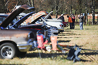 Attendees admire cars, Sunday, November 15, 2020 during a car show at the Holland Barn in Highfill. Michael Ratledge and Shane Hargrave founders of Gravette Cruise and Quarantine organized a car show fundraiser to raise money for the Arkansas children's shelter. One hundred percent of proceeds will go to the shelter said Ratledge. Check out nwaonline.com/201116Daily/ for today's photo gallery. <br /> (NWA Democrat-Gazette/Charlie Kaijo)