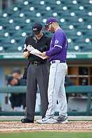 Furman Paladins head coach Brett Harker (31) goes over lineup changes with home plate umpire Jon Byrne during the game against the Wake Forest Demon Deacons at BB&T BallPark on March 2, 2019 in Charlotte, North Carolina. The Demon Deacons defeated the Paladins 13-7. (Brian Westerholt/Four Seam Images)
