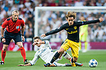 Cristiano Ronaldo (l) of Real Madrid fights for the ball with Antoine Griezmann of Atletico de Madrid with referee <br /> Martin Atkinson watching on during their 2016-17 UEFA Champions League Semifinals 1st leg match between Real Madrid and Atletico de Madrid at the Estadio Santiago Bernabeu on 02 May 2017 in Madrid, Spain. Photo by Diego Gonzalez Souto / Power Sport Images