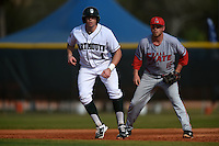 Dartmouth Big Green outfielder Nick Ruppert (1) leads off in front of first baseman Brandon Estep (15) during a game against the Ball State Cardinals on March 7, 2015 at North Charlotte Regional Park in Port Charlotte, Florida.  Ball State defeated Dartmouth 7-4.  (Mike Janes/Four Seam Images)