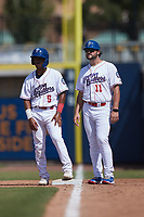 Kannapolis Cannon Ballers first base coach Patrick Leyland (11) chats with Misael Gonzalez (5) during the game against the Lynchburg Hillcats at Atrium Health Ballpark on August 29, 2021 in Kannapolis, North Carolina. (Brian Westerholt/Four Seam Images)