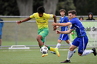 Noah Karunaratne of Lower Hutt AFC competes for the ball with Alex Shepherd-Reynolds of Petone FC during the Central League Football - Petone FC v Lower Hutt AFC at Petone Memorial Park, Lower Hutt, New Zealand on Friday 2 April 2021.<br /> Copyright photo: Masanori Udagawa /  www.photosport.nz