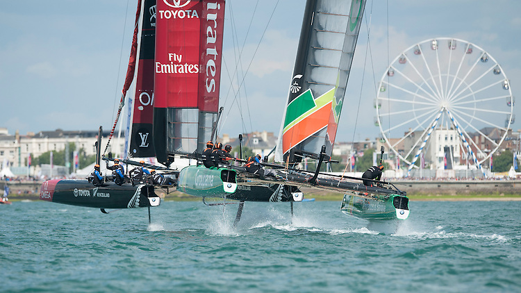 25 July 2015: Emirates Team New Zealand ahead of Groupama Team France during the America's Cup first round racing off Portsmouth, England (Photo by Rob Munro)