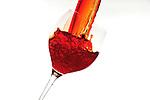 Splashes of coloured liquids insie a glass.