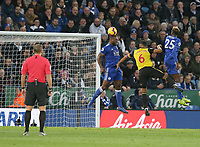 Watford's Adrian Mariappa battles against Leicester City's Wes Morgan (left) and Wilfred Ndidi <br /> <br /> Photographer Stephen White/CameraSport<br /> <br /> The Premier League - Leicester City v Watford - Saturday 1st December 2018 - King Power Stadium - Leicester<br /> <br /> World Copyright © 2018 CameraSport. All rights reserved. 43 Linden Ave. Countesthorpe. Leicester. England. LE8 5PG - Tel: +44 (0) 116 277 4147 - admin@camerasport.com - www.camerasport.com