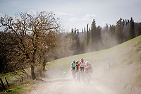 Tomasz Marczyński (POL/Lotto-Soudal), Tim Wellens (BEL/Lotto-Soudal) & Tiesj Benoot (BEL/Lotto-Soudal) up the tempo in the peloton in pursuit of the 4 race leaders<br /> <br /> 13th Strade Bianche 2019 (1.UWT)<br /> One day race from Siena to Siena (184km)<br /> <br /> ©kramon