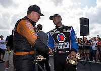 May 11, 2013; Commerce, GA, USA: NHRA funny car winner Johnny Gray (left) congratulates top fuel dragster driver Antron Brown after winning the Southern Nationals at Atlanta Dragway. Mandatory Credit: Mark J. Rebilas-