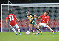 July 31, 2012..South Africa's Sanah Mollo (14), Japan's Asuna Tanaka (14) and Saki Kumagai (4) in action during Football match between JPN and RSA at the Millennium Stadium on day four of 2012 Olympic Games in Cardiff, United Kingdom...