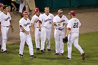 South Carolina relief pitcher is greeted by his teammates following another shut out inning in Game Two of the NCAA Division One Men's College World Series Finals on June 29th, 2010 at Johnny Rosenblatt Stadium in Omaha, Nebraska.  (Photo by Andrew Woolley / Four Seam Images)
