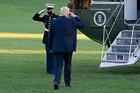 United States President Donald J. Trump salutes the Marine Guard as he departs the White House in Washington, DC en route to a political event in Johnstown, Pennsylvania on Tuesday, October 13, 2020.<br /> CAP/MPI/RS<br /> ©RS/MPI/Capital Pictures