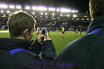 Birmingham City 0 Liverpool 7, 21/03/2006. St Andrews, FA Cup 6th Round. Birmingham City (blue) versus Liverpool,  The home side lost 0-7. Picture shows a member of the City groundstaff keeping tabs on the opposition with his mobile phone. Photo by Colin McPherson.