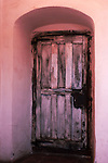 Door leading from priest quarters to sanctuary at Mission La Purisima, Lompoc, CA, part of the old Spanish mission system.