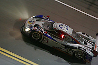The #50 BMW Riley of Byron Defoor, Jim Pace, Frank Beck, and David Hinton races under the lights during the Rolex 24 at Daytona, Daytona International Speedway, Daytona Beach, FL, January 2014.  (Photo by Brian Cleary/www.bcpix.com)