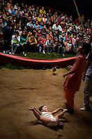 The children of the owners of the Jhon Danyer Circus in the ring during the interval of a performance. Around a dozen small circuses wander the poorer neighbourhoods around the city of Medellin putting on performances in what can be a hand to mouth existence. Despite falling audience numbers, new health and safety regulations and other bureaucracy these small family businesses, many of whom have existed for generations, still scrape a living in a world where the people are more accustomed to being entertained by soap operas than by live entertainment..