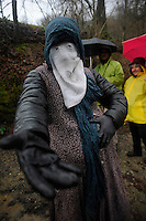 A masked woman performs during an ancient carnival on January 27, 2014 at the village of Ituren, Basque Country. Joaldun groups perform an ancient traditional carnival at the villages of Ituren and Zubieta during two days, carrying sheep furs and big cowbells in their backs and making sound them in order to wake up the earth, to ask for a good new year, a good harvest and also to keep away the bad spirits. (Ander Gillenea / Bostok Photo)