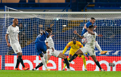 4th November 2020, Stamford Bridge, London, England;  Chelseas Tammy Abraham shoots the ball against Rennes Dalbert, who was judged to have handled the ball after a VAR review and was then sent off for a second yellow card, during the UEFA Champions League Group E match between Chelsea and Rennes at Stamford BridgeER
