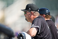 Kannapolis Intimidators pitching coach Brian Drahman (45) watches the action from the dugout during the game against the Greensboro Grasshoppers at Intimidators Stadium on July 17, 2016 in Greensboro, North Carolina.  The Intimidators defeated the Grasshoppers 3-2 in game one of a double-header.  (Brian Westerholt/Four Seam Images)
