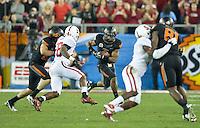 STANFORD, CA - January 2, 2012: Oklahoma State running back Joseph Randle (1) against Stanford at the Fiesta Bowl at University of Phoenix Stadium in Phoenix, AZ. Final score Oklahoma State wins 41-38.