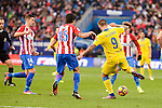 "Atletico de Madrid Gabriel ""Gabi"" Fernández and Stefan Savic and UD Las Palmas Marko Livaja during La Liga match between Atletico de Madrid and UD Las Palmas at Vicente Calderon Stadium in Madrid, Spain. December 17, 2016. (ALTERPHOTOS/BorjaB.Hojas)"